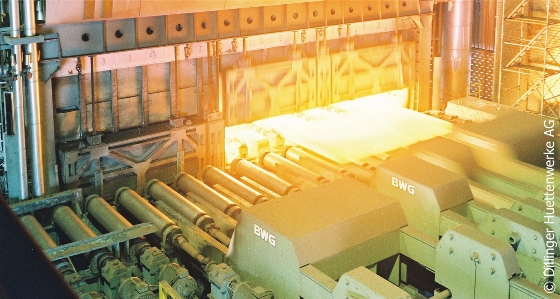 A hot slab is discharged from the furnace, Copyright: Dillinger Hüttenwerke AG.